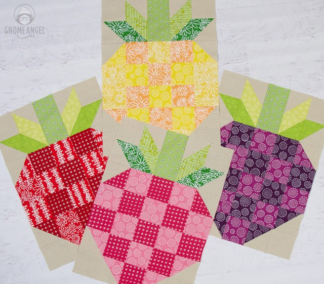 """Strawberry Quilt Block - Learn to make this large strawberry quilt block on www.GnomeAngel.com - Block finished at 17.5"""" x 24.5"""" and is great for a quick large quilt finish, using up your scraps and having fun with colour. Perfect summer quilt. This version is made featuring Karen Lewis Blueberry Park for Robery Kaufman partnered with Robert Kaufman Essex Linen. See more at www.GnomeAngel.com"""